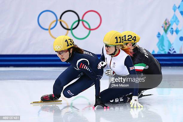 Elise Christie of Great Britain falls and collides with SeungHi Park of South Korea and Arianna Fontana of Italy during the Short Track Speed Skating...