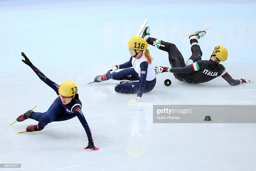 <a gi-track='captionPersonalityLinkClicked' href=/galleries/search?phrase=Elise+Christie&family=editorial&specificpeople=4113885 ng-click='$event.stopPropagation()'>Elise Christie</a> of Great Britain (C) falls and collides with Seung-Hi Park of South Korea (L) and <a gi-track='captionPersonalityLinkClicked' href=/galleries/search?phrase=Arianna+Fontana&family=editorial&specificpeople=4680451 ng-click='$event.stopPropagation()'>Arianna Fontana</a> of Italy (R) as she competes in the Short Track Speed Skating Ladies' 500 m Final on day 6 of the Sochi 2014 Winter Olympics at at Iceberg Skating Palace on February 13, 2014 in Sochi, Russia.