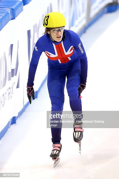 Elise Christie of Great Britain holds her leg after colliding with Veronique Pierron of France during the semifinals of the Women's 1000m race on day...