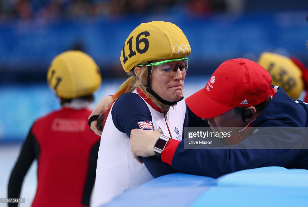 <a gi-track='captionPersonalityLinkClicked' href=/galleries/search?phrase=Elise+Christie&family=editorial&specificpeople=4113885 ng-click='$event.stopPropagation()'>Elise Christie</a> of Great Britain is consoled after the Short Track Speed Skating Ladies' 500 m Final on day 6 of the Sochi 2014 Winter Olympics at at Iceberg Skating Palace on February 13, 2014 in Sochi, Russia.