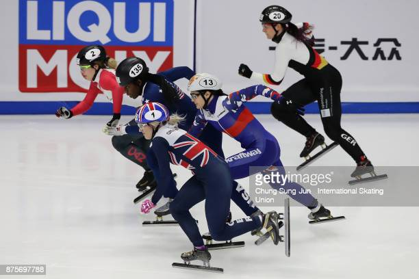 Elise Christie of Great Britain Marianne StGelais of Canada and Maame Biney of United States compete in the Ladies 500m Quarterfinals during the Audi...