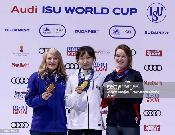 Elise Christie of Great Britain poses during the medal ceremony after winning the 3rd place Jeong Min Choi of Korea poses during the medal ceremony...