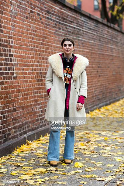 Elise Hoggard wears a vintage offwhite coat with a fur collar a cerise buttonup shirt HarleyDavidson tshirt light flared jeans brown suede boots and...