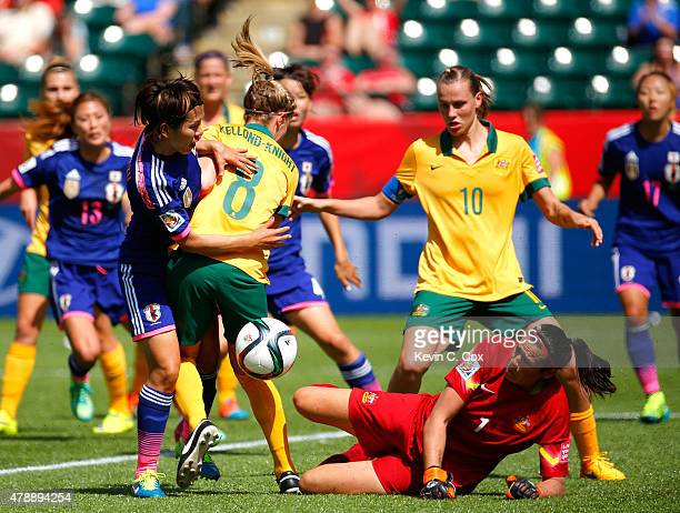 Elise KellondKnight defends as goalkeeper Lydia Williams of Australia attempts to save the ball against Azusa Iwashimizu of Japan during the FIFA...