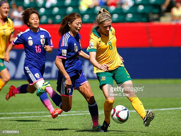 Elise KellondKnight of Australia against Rumi Utsugi of Japan during the FIFA Women's World Cup Canada 2015 Quarter Final match between Australia and...