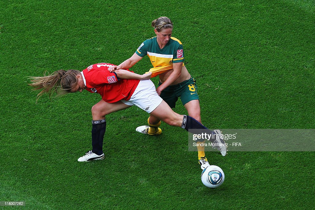 Elise Kellond-Knight of Australia is challenged by Hedda Gardsjord of Norway during the FIFA Women's World Cup Group D match between Australia and Norway at the FIFA World Cup stadium Leverkusen on July 6, 2011 in Leverkusen, Germany.