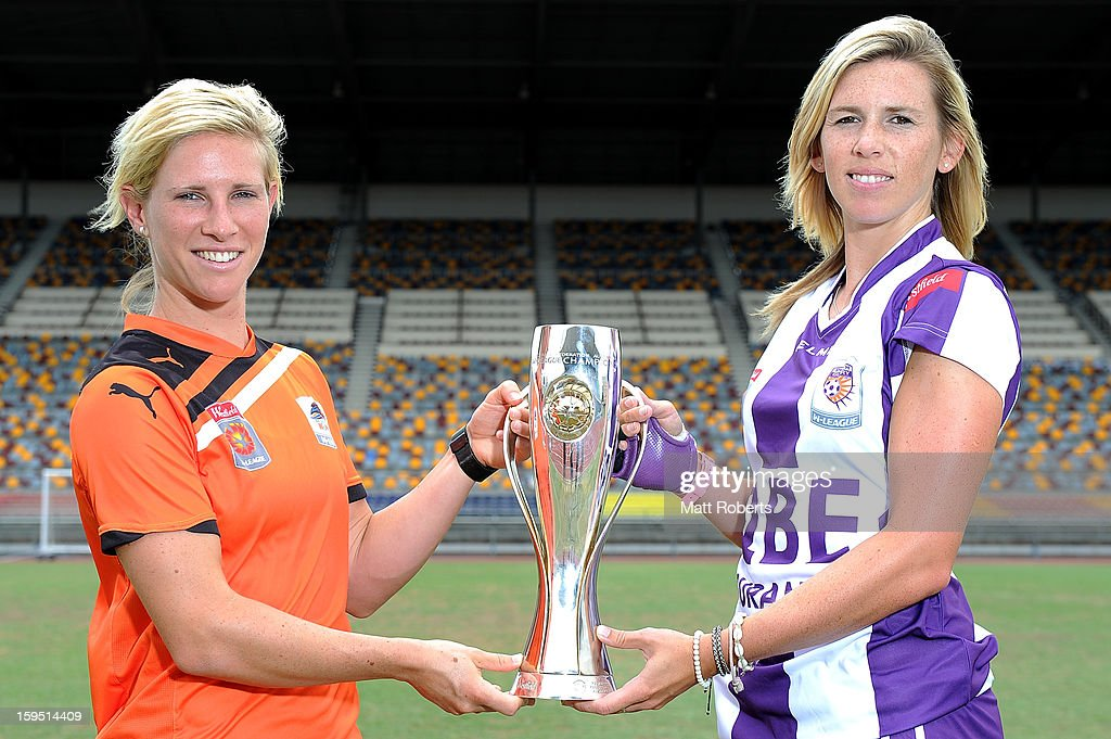 Elise Kellond-Knight of the Roar and Carly Telford of the Glory pose with the W-League trophy during the W-League FFA finals series launch at Queensland Sport and Athletics Centre on January 15, 2013 in Brisbane, Australia.