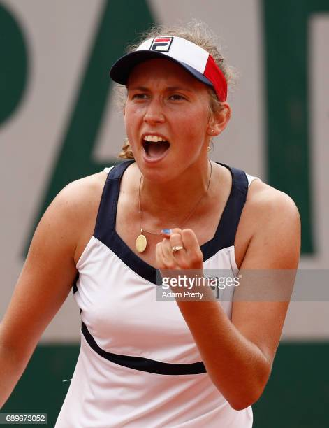 Elise Mertens of Belgium celebrates during the ladies singles first round match against Daria Gavriola of Australia on day two of the 2017 French...