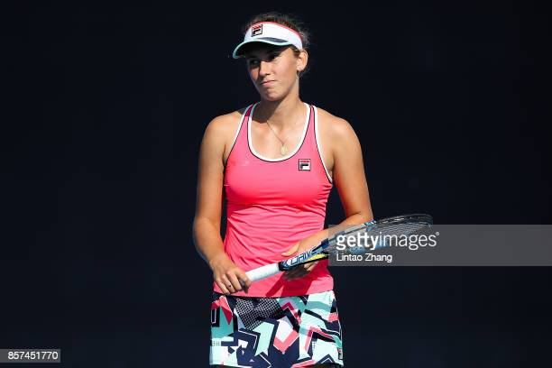 Elise Mertens of Belgium reacts after losing the point against Caroline Garcia of France during the Women's singles second round on day five of 2017...