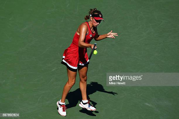 Elise Mertens of Belgium returns a shot to Garbiñe Muguruza of Spain during her first round Women's Singles match on Day One of the 2016 US Open at...