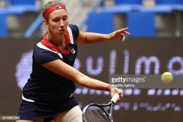 Elise Mertens of Belgium returns the ball during the TEB BNP Paribas Istanbul Cup Women's Couple tennis match between Cagla Buyukakcay of Turkey...