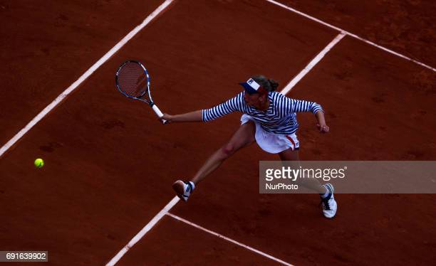 Elise Mertens of Belgium returns the ball to Venus Williams of United States during the third round at Roland Garros Grand Slam Tournament Day 6 on...