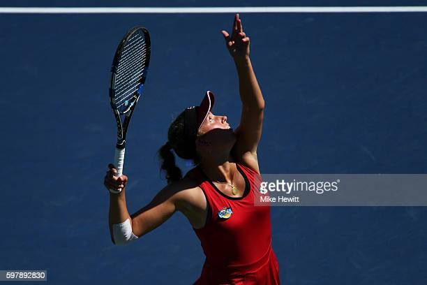 Elise Mertens of Belgium serves to Garbiñe Muguruza of Spain during her first round Women's Singles match on Day One of the 2016 US Open at the USTA...