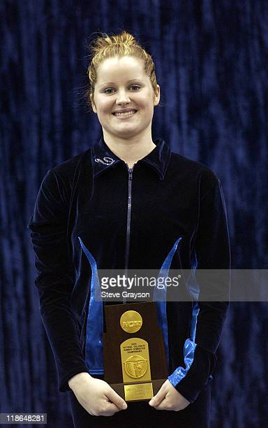 Elise Ray of Michigan first place winner in the Uneven Parallel Bars at the 2004 NCAA Championship Individual Finals at Pauley Pavilion in Westwood...