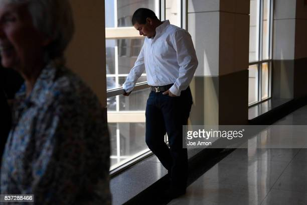 Eliseo Jurado waits as his partner Ingrid Encalada Latorre talks to the media after her hearing at the Jefferson County Courthouse She will learn of...