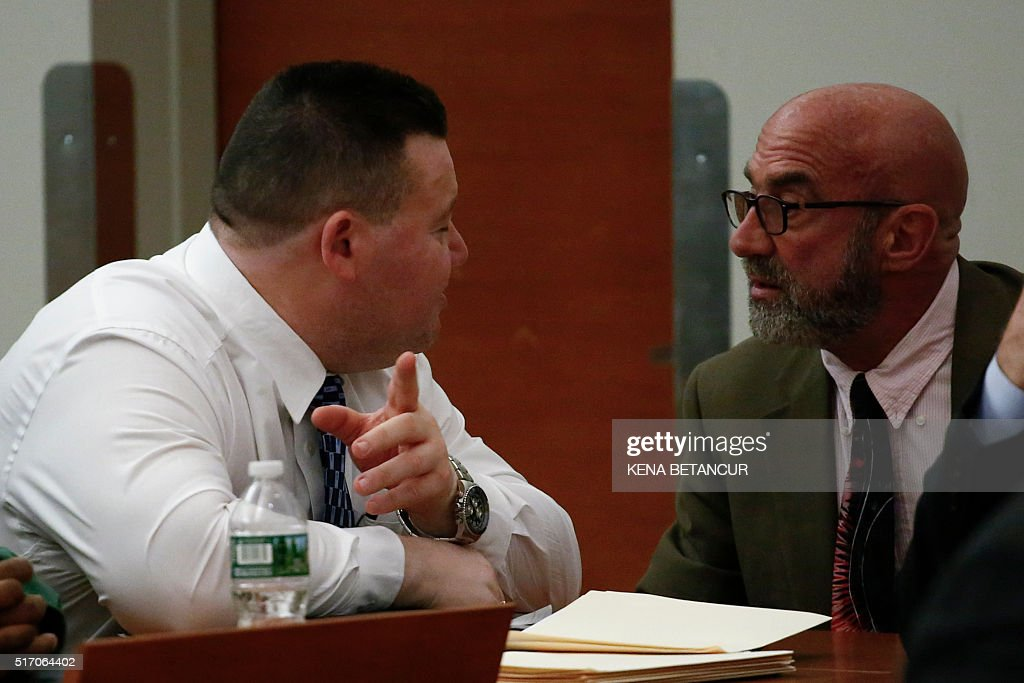 Eliseo Perez Jr an assistant chief for security at Rikers Island correctional facility speaks with his defense lawyer Robert J Feldman during the...