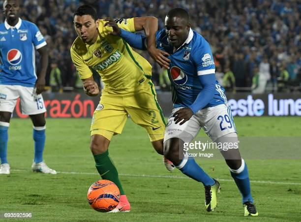 Eliser Quiñonez of Millonarios fights for the ball with Daniel Bocanegra of Atletico Nacional during the Semi Finals first leg match between...