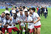 Eliseu Eder Jose Fonte Nani and Andre Gomes of Portugal celebrate during the European Championship Final between Portugal and France at Stade de...