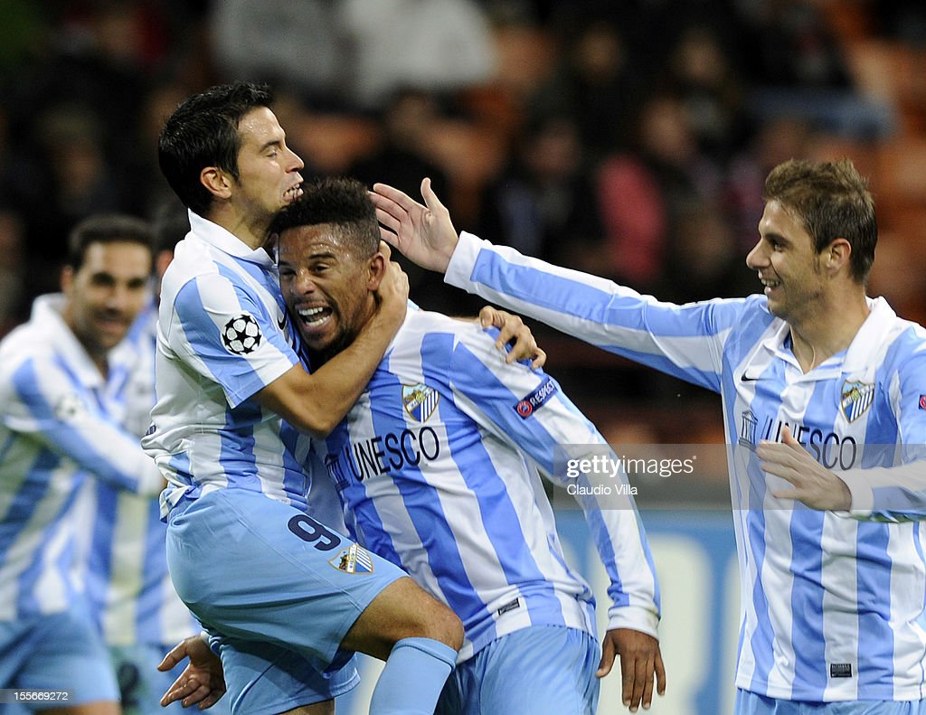 Eliseu of Malaga CF celebrates scoring the first goal during the UEFA Champions League group C match between AC Milan and Malaga CF at Stadio...