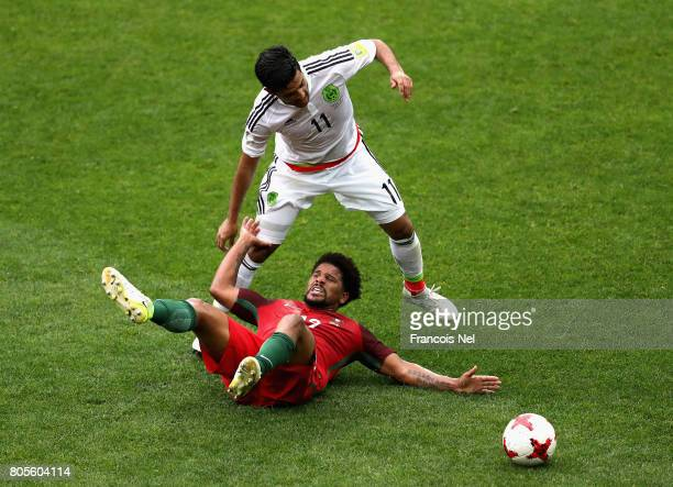 Eliseu of Portugal and Carlos Vela of Mexico battle for possession during the FIFA Confederations Cup Russia 2017 PlayOff for Third Place between...
