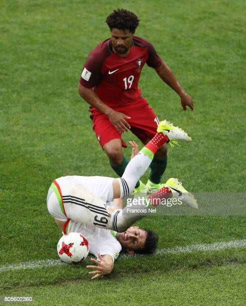 Eliseu of Portugal and Hector Herrera of Mexico battle for possession during the FIFA Confederations Cup Russia 2017 PlayOff for Third Place between...