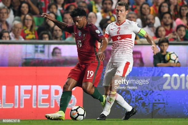 Eliseu of Portugal competes for the ball with Stephan Lichtsteiner of Switzerland during the FIFA 2018 World Cup Qualifier between Portugal and...