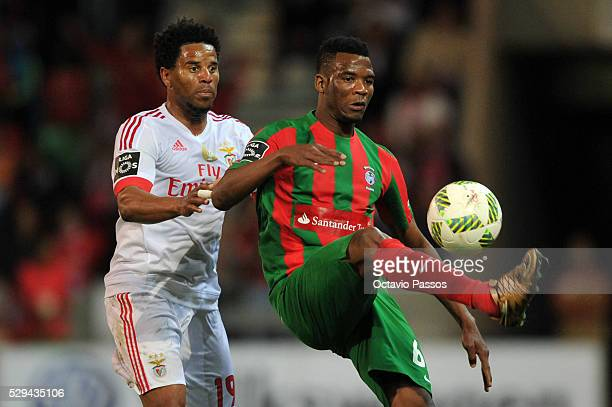 Eliseu of SL Benfica challenges Donald Djouss�� of CS Maritimo during the Portuguese Primeira Liga at Estadio dos Barreiros on May 8 2016 in Funchal...