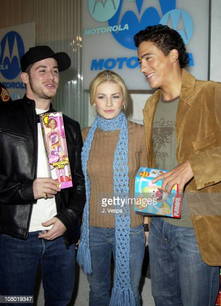 Elisha Cuthbert and Andrew Keegan with guest during Motorola 4th Annual Holiday Party Arrivals at The Lot in Hollywood California United States