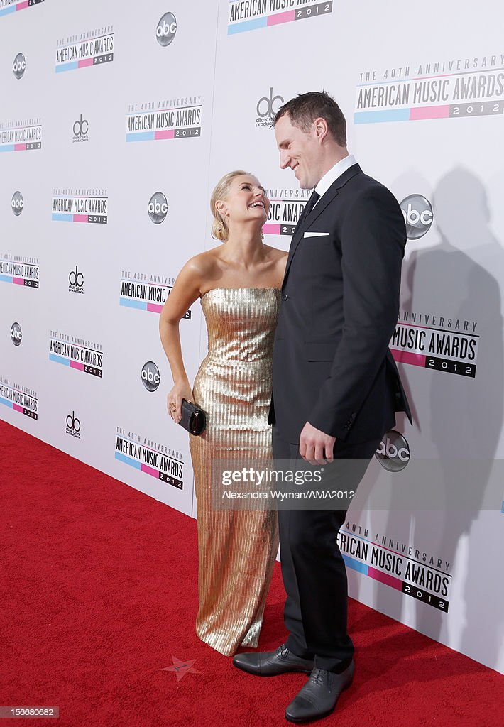 Elisha Cuthbert and Dion Phaneuf attends the 40th American Music Awards held at Nokia Theatre L.A. Live on November 18, 2012 in Los Angeles, California.