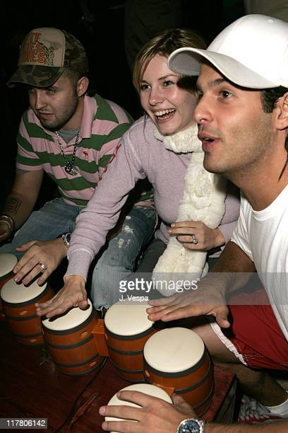 Elisha Cuthbert gets into the beat with Donkey Konga a new video game for Nintendo Game Cube during a Sept 27th Hollywood party to kick off the...
