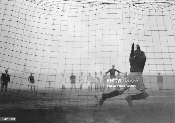 Elisha Scott saves a penalty goal during a Liverpool versus Arsenal 1st round FA Cup match
