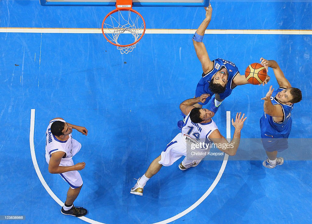 Elishay Kadir of Israel, Yaniv Green of Israel, Andrea Bargnani and Stefano Mancinelli of Italy fight for the ball during the EuroBasket 2011 first round group B match between Israel and Italy at Siauliai Arena on September 5, 2011 in Siauliai, Lithuania.
