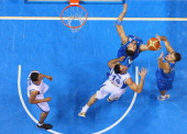 Elishay Kadir of Israel Yaniv Green of Israel Andrea Bargnani and Stefano Mancinelli of Italy fight for the ball during the EuroBasket 2011 first...