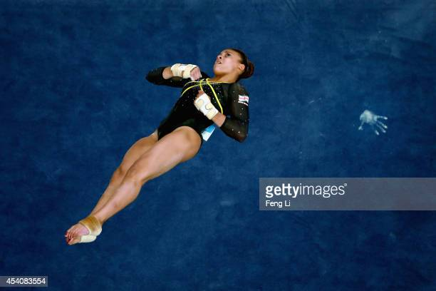 Elissa Downie of Great Britain competes in the Women's Floor Exercise Final on day eight of the Nanjing 2014 Summer Youth Olympic Games at Nanjing...