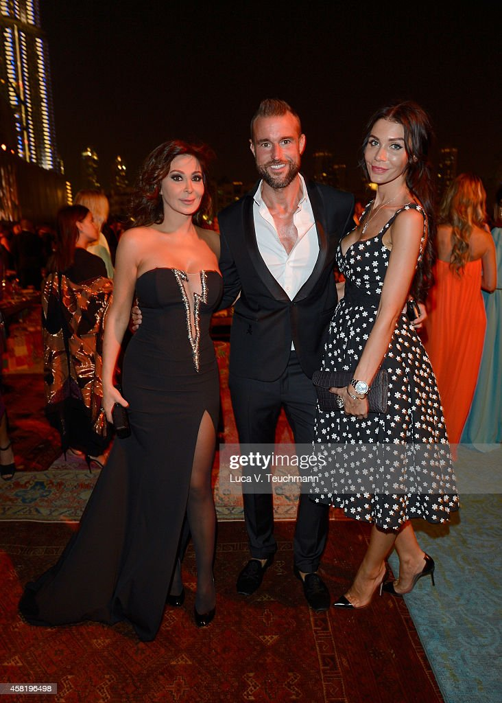 <a gi-track='captionPersonalityLinkClicked' href=/galleries/search?phrase=Elissa&family=editorial&specificpeople=641088 ng-click='$event.stopPropagation()'>Elissa</a>, Philipp Plein and guest at the Gala Event during the Vogue Fashion Dubai Experience on October 31, 2014 in Dubai, United Arab Emirates.