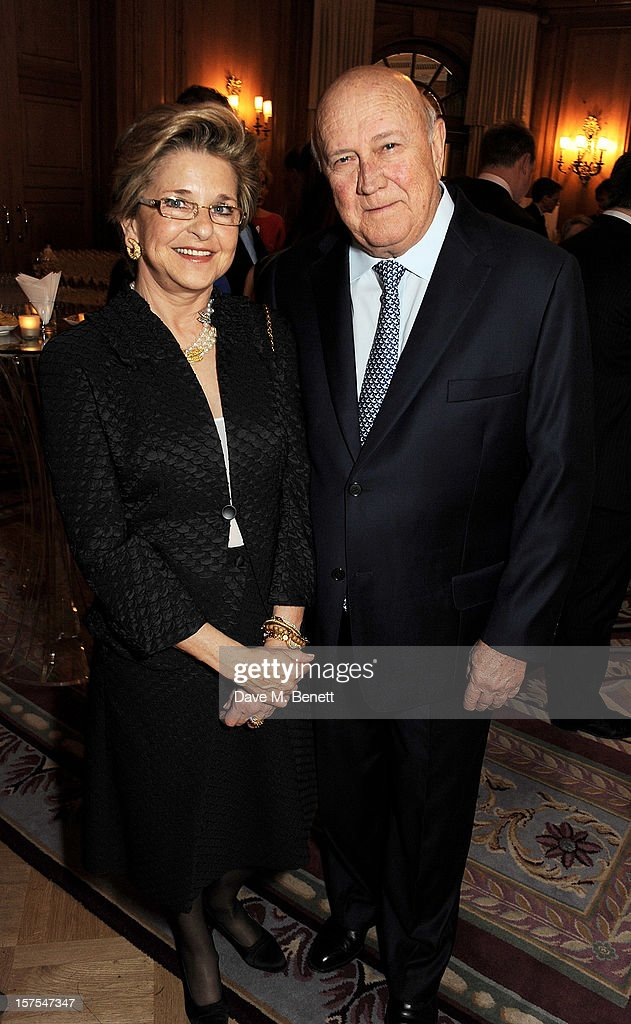 Elita Georgiades (L) and former South African President F.W. de Klerk attends a cocktail reception at the 4th Fortune Forum Summit held at The Dorchester on December 4, 2012 in London, England.