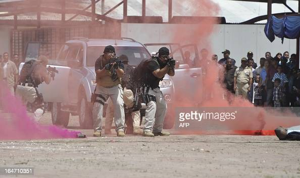 Elite East Timorese police commandos take part in a mock rescue of a hostage during the 13th anniversary celebration of the East Timor National...
