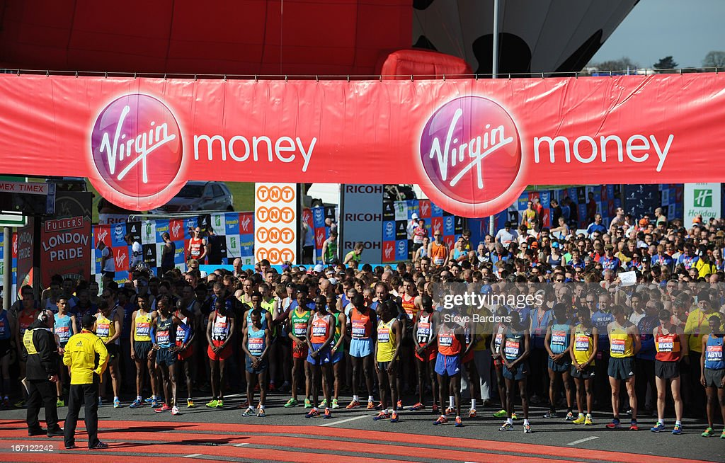 Elite Men runners and fellow competitors observe a minutes silence in memory of victims of the Boston Marathon bombing at the start of the Virgin London Marathon 2013 on Blackheath Common on April 21, 2013 in London, England.