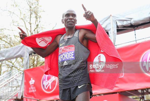 Elite mens winner Eluid Kipchoge of Kenya celebrates after the Virgin Money Giving London Marathon at the finish on The Mall on April 24 2016 in...