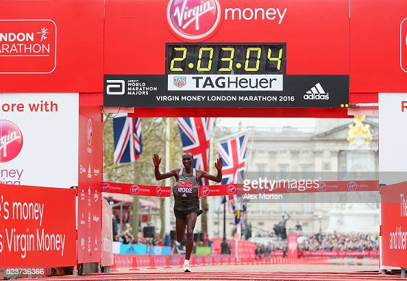Elite mens winner Eluid Kipchoge of Kenya crosses the line after the Virgin Money Giving London Marathon at the finish on The Mall on April 24 2016...