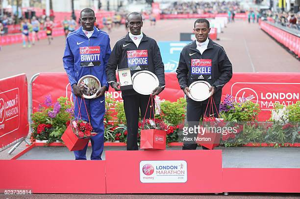 Elite mens winner Eluid Kipchoge of Kenya second place Stanley Biwott of Kenya and third place Kenenisa Bekele of Ethopia after the Virgin Money...