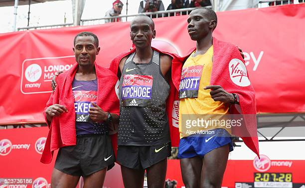 Elite mens winner Eluid Kipchoge of Kenya second place Stanley Biwott of Kenya and third place Kenenisa Bekele of Ethopia pose after the Virgin Money...
