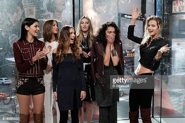 Elite Model Search 2016 finalists Genevieve van Dam Laurel Magin Nell Trotter and Rylee Webber look on as Elite Ambassador Kate Bock announces Kayle...