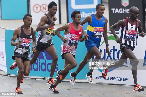 Elite runners Amanuel Mesel of Eritrea Tewelde Estifanos of Eritrea and Tsegai Tewelde of Great Britain take part in the 2016 London Marathon in...