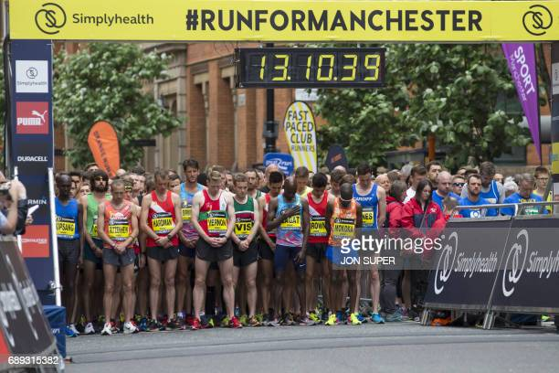 TOPSHOT Elite runners observe a minute of silence for the victims of the Manchester Arena bombing before the start of the Great Manchester Run in...
