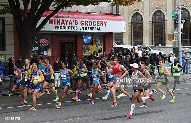 Elite runners run through the streets of Brooklyn during TCS New York City Marathon in New York November 1 2015 AFP PHOTO / DON EMMERT