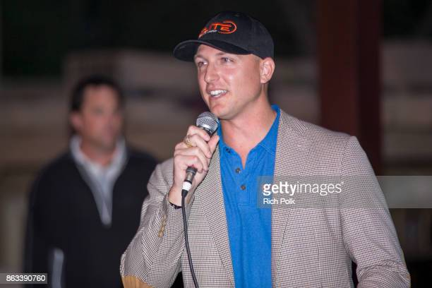 Elite Veterans Initiative CoPresident Dustin Tillman speaks on stage at the Swing Fore The Vets Charity Golf Tournament on October 19 2017 in Rancho...