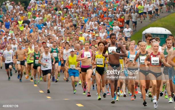 Elite women runners lead a mass of runners away from the start of the 17th annual TD Beach to Beacon 10K road race in Cape Elizabeth on Saturday...