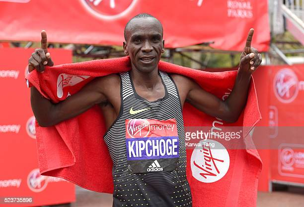 Eliud Kipchoge celebrates after winning the Mens Virgin London Marathon 2016 on April 24 2016 in London England