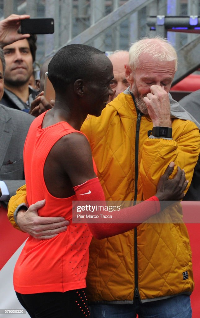 Eliud Kipchoge embraces with Sandy Bodecker VP action Sport at Nike at the finish area during the Nike Breaking2: Sub-Two Marathon Attempt at Autodromo di Monza on May 6, 2017 in Monza, Italy.